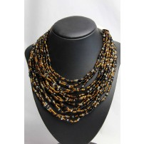 Collar style multi strand necklace in amber, black...
